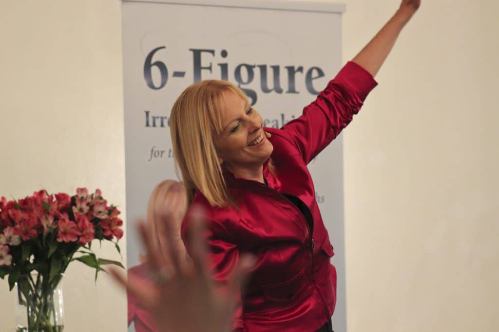 Speech coach and author AmondaRose Igoe on stage, 7-Step Process on How to Get Speaking Engagements that Help You To Grow as a Speaker