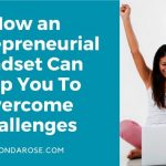 woman with long brown hair and white top, raising her arms in the air, in front of her white laptop, How an Entrepreneurial Mindset Can Help You to Overcome Challenges